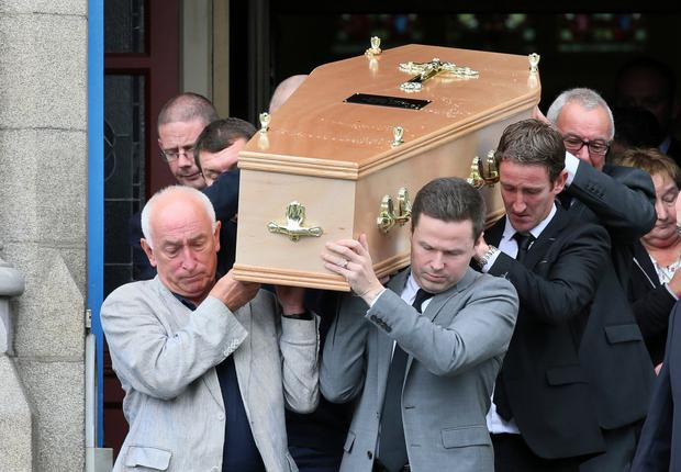 Stephen Keenan's coffin is taken out of the church – tributes were paid to the diving instructor, who died in Egypt