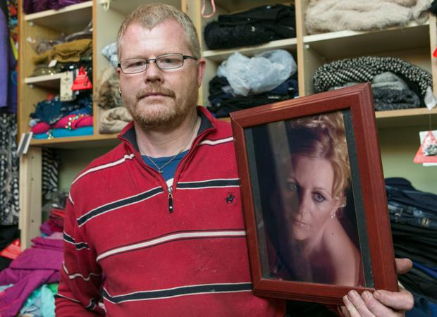 Richard Satchwell with photo of his missing wife, Tina