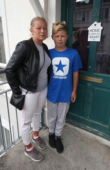 Ana Wojdylo and her son Dominik outside their apartment