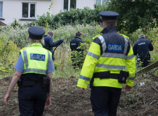 Gardai at the site where Mr Deely may have been buried
