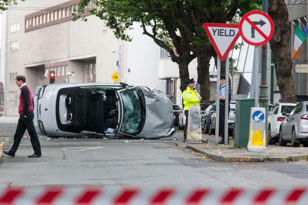 A Saab car left on its side after the incident