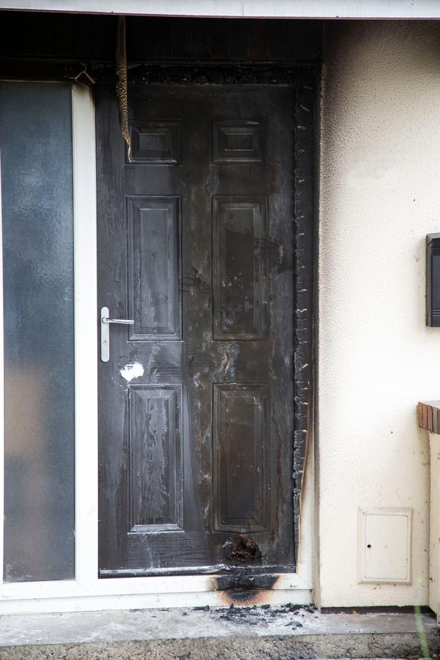 The doorway of the house in Loughlinstown attacked with petrol bombs early yesterday morning