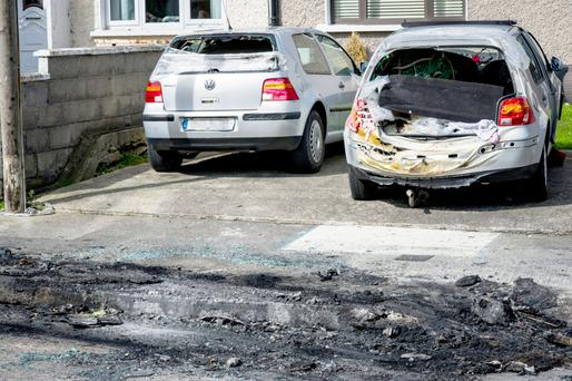 The back of the car melted after the bomb went off in the Lough Conn Avenue estate. Photo: Douglas O'Connor/www.doug.ie