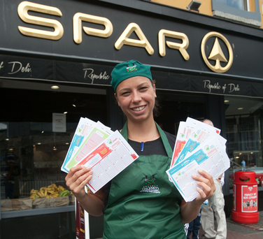 Spar worker Anna Horvat celebrates after the winning ticket was bought at the Talbot Street shop on Saturday. Photo: Collins