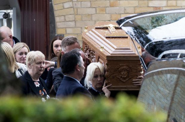 Mourners carry the coffin of Clinton 'Clint' Shannon