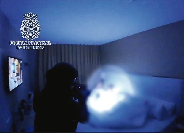 Armed police burst into the bedroom