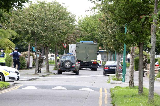 Gardai and members of the Defence Forces dealing with the bomb scare at St Aidan's Park in Marino