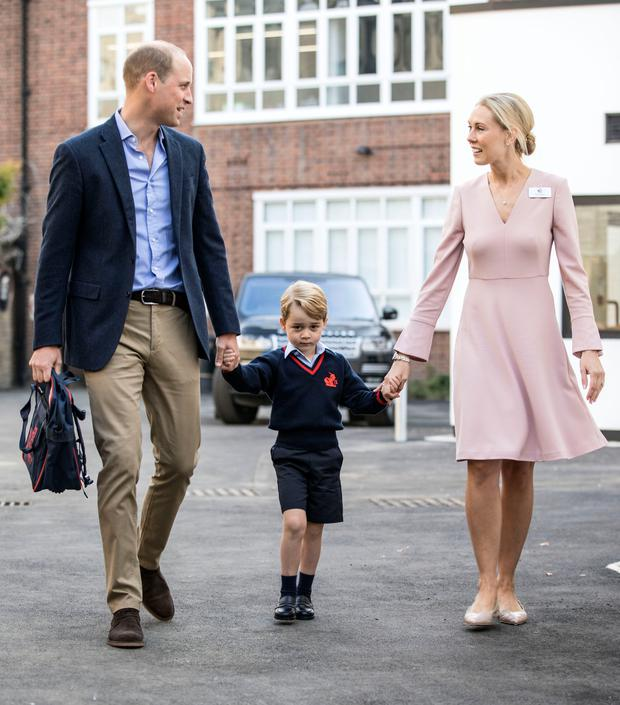 George walks across the school yard with his father and head Helen Haslem.