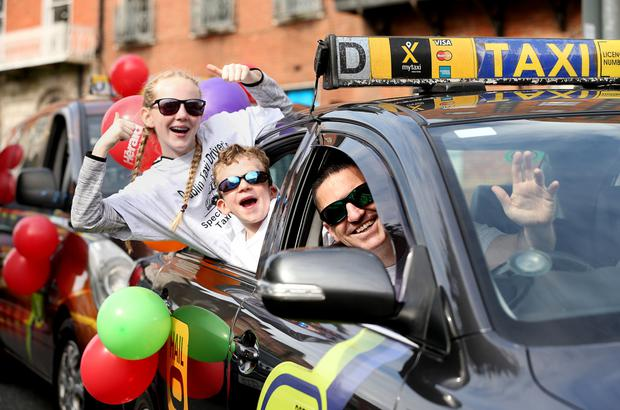 Dublin Taxi Drivers day out for Children. Driver Pat Doyle with Mya and Keelin Pardy on board as the taxis depart from the start of the run at Parnell Square. Photo: Gerry Mooney