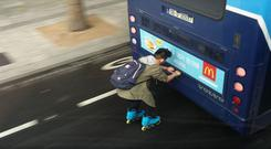 The rollerblader clung on to a 38A bus for about 20 seconds as it travelled along O'Connell Street in the evening rush hour