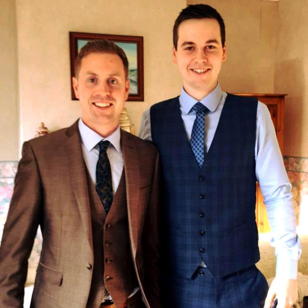 Gary Askin (left) died after rescuing his brother Stephen, who had become trapped in an overhead bin