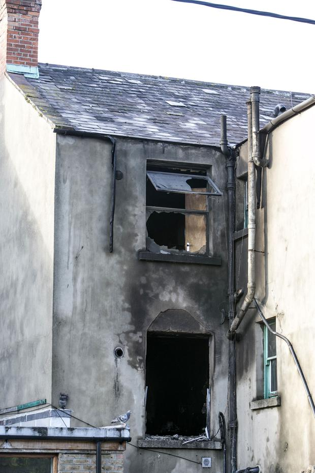 Charred window frames show the intensity of the fire