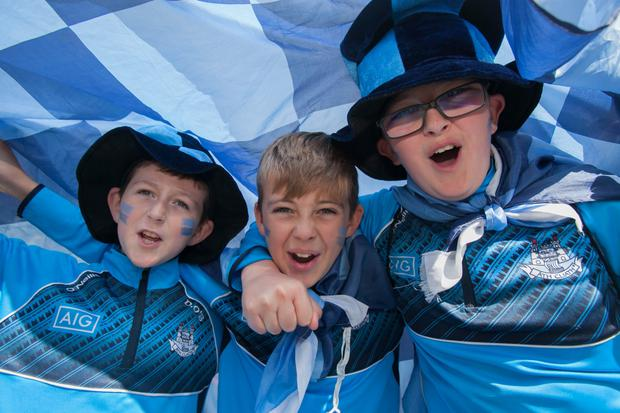 Dublin fans and brothers Jason, Dylan, and Christian O'Sullivan from Palmerstown Pic: Collins