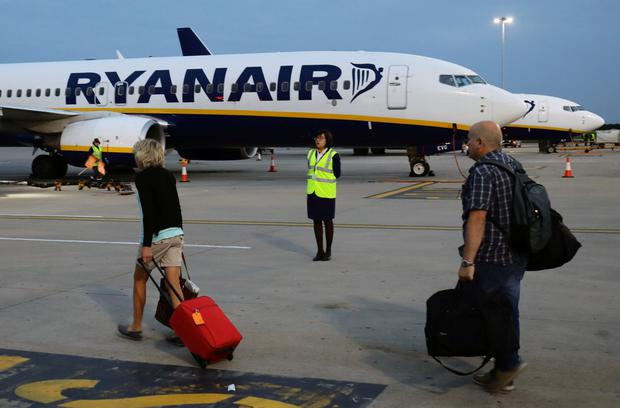 Passengers board a Ryanair flight at Stansted Airport. Photo: REUTERS