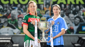 Mayo's Sarah Tierney and Dublin's Sinead Aherne with the cup. Photo: SPORTSFILE