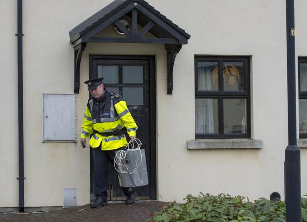 A garda outside the house in Ardee