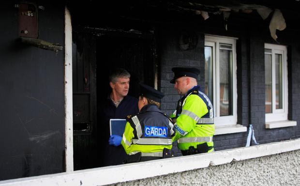 Gardai at the scene of the fire in Tyrone Place