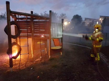 Firefighters tackle the blaze which destroyed a play area in Coultry Park, one of a spate of incidents