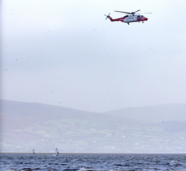 Windsurfers at Blackrock as a rescue helicopter hovers overhead