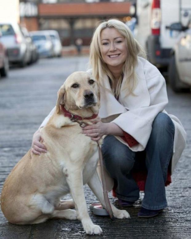 Dog Tales author Andrea Hayes with her pet Labrador Dash