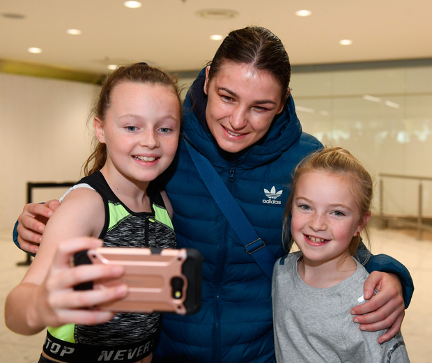 Katie Taylor is welcomed at Dublin Airport by Jenna Dunphy (11) and Ruby Butler (9) Photo: Sportsfile