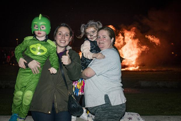 Lisa, David, Maggie and Frances Deegan enjoy the bonfires on Halloween in Darndale. Photo: Arthur Carron