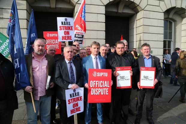 Greg Ennis, Dermot O'Leary and the TSSA's Manuel Cortez join Irish Rail workers on the picket line at Heuston Station.