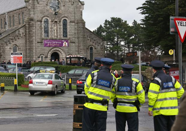 A heavy Garda presence as the remains of Michael 'Mad Mickey' Devoy. Photo: Collins