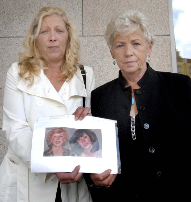 Antoinette Keegan and her mother Christine with a picture of Martina and Mary Keegan, who died in the Stardust disaster