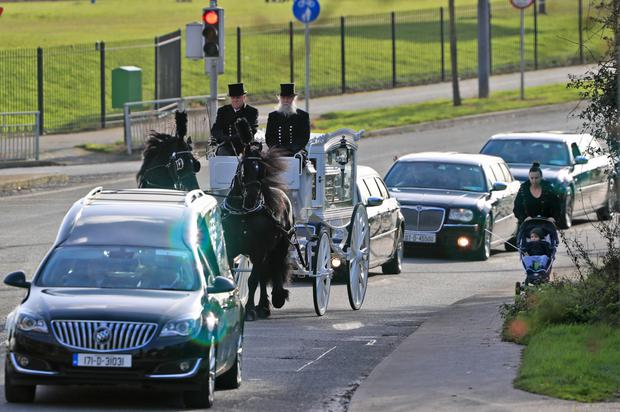 Remains of Jamie Tighe are brought to his funeral. Photo: Colin Keegan