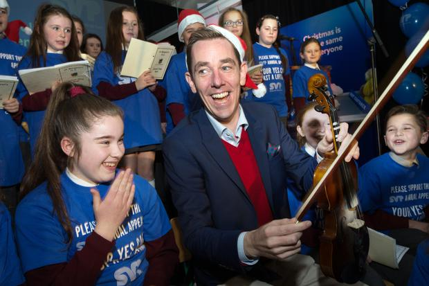 Ryan Tubridy with children from St Margaret's School Choir, Dublin at the launch of the St Vincent de Paul Christmas Appeal at their HQ in Sean McDermot St.