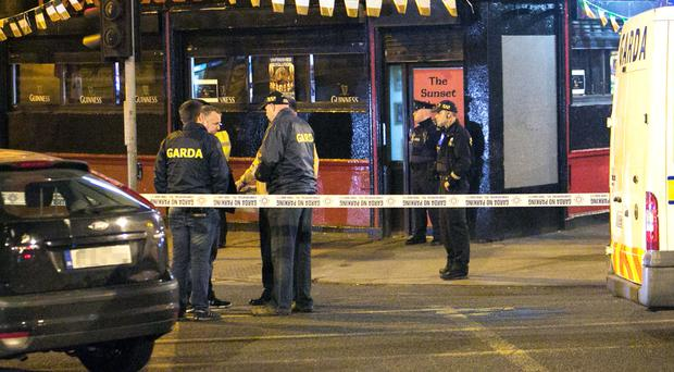 Members of the Gardai beside the scene of a shooting at the Sunset House Pub in Ballybough, Dublin