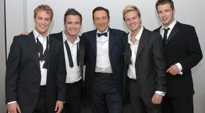 Westlife with under-fire actor Kevin Spacey in 2004