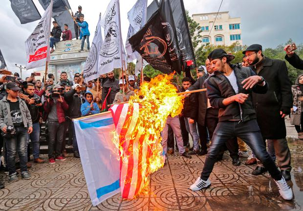 Palestinian protesters burn US and Israeli flags in Gaza City