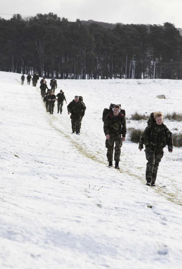 Defence Forces personnel march in the snow at the Curragh. Photo: Eamonn Farrell/RollingNews.ie