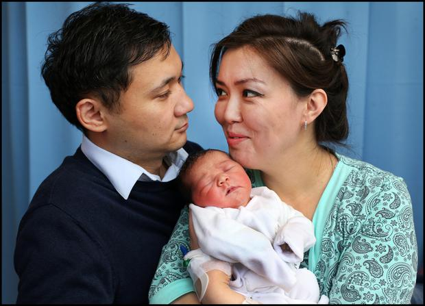 Dad Kuna and mum Aigerim Utegnova, from Spencer Dock, Dublin, with their baby girl at Holles Street National Maternity Hospital