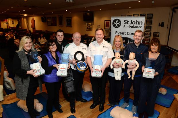 St John Ambulance members Michael Cardiff and Padraig Allen with some of the volunteers