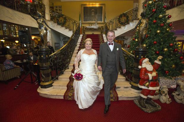 Linda and Adrian on the stairs at the Bridge House Hotel