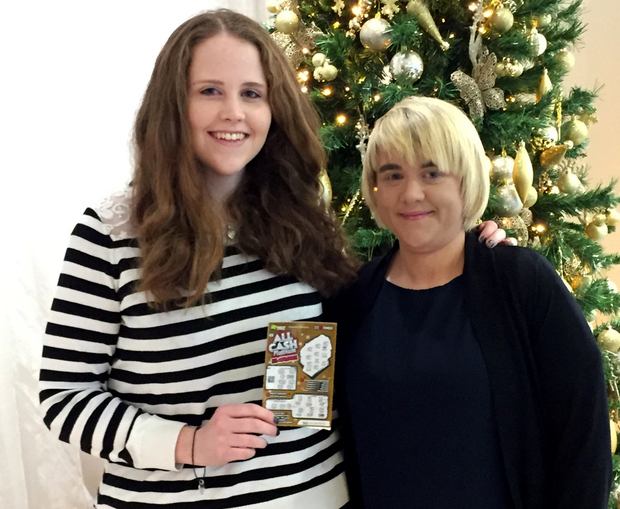 Young mum Ciara Douglas won €50,000 with an All Cash Platinum scratch card gifted by her sister Orla (right)