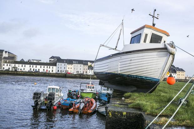 A fishing Boat washed up on the Quay at the Claddagh in Galway City after the flooding