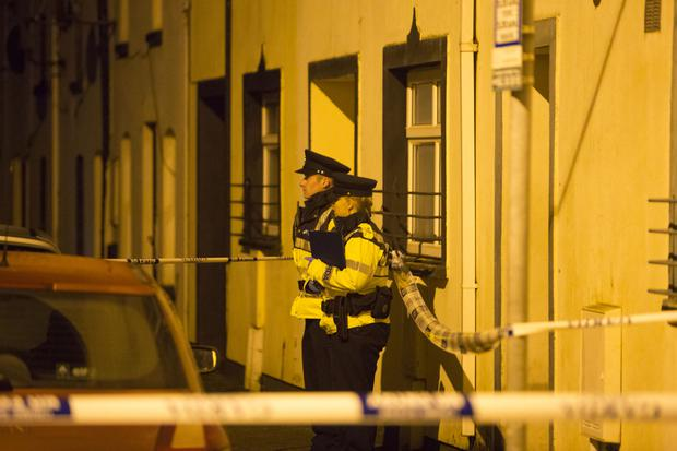 Gardai at the door of the flat in Little O'Curry Street