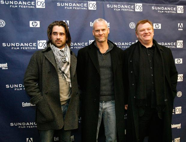 McDonagh poses with cast members Farrell and Gleeson at the premiere of