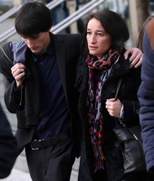 Catherine Carolan, the mother of murdered Leo Carolan is comforted outside court by her other son, Alex, after Leo's killer was sentenced. Photo: Collins Courts