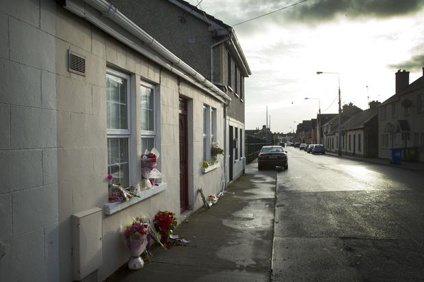 Flowers outside the home of widow Rose Hanrahan