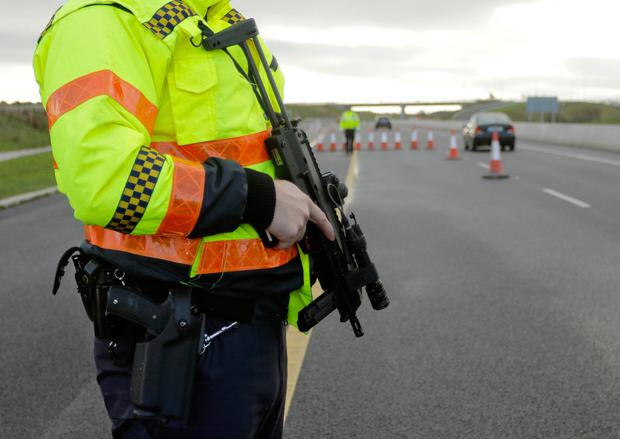 An armed garda checkpoint during Operation Thor