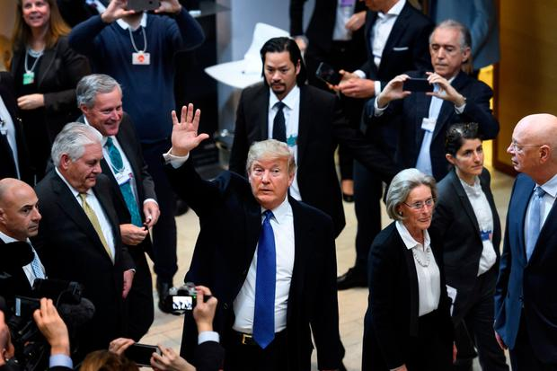 Donald Trump waves on his arrival at Davos