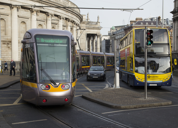 Traffic at College Green, where trams, cars, buses, cyclists and pedestrians vie for space