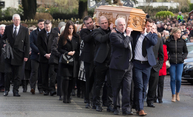 The coffin of Liam Miller is carried following the funeral service at St John the Baptist Church in Ovens, Co Cork