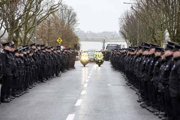 The hearse carrying Detective Superintendent Colm Fox from his funeral mass in Malahide, Dublin.