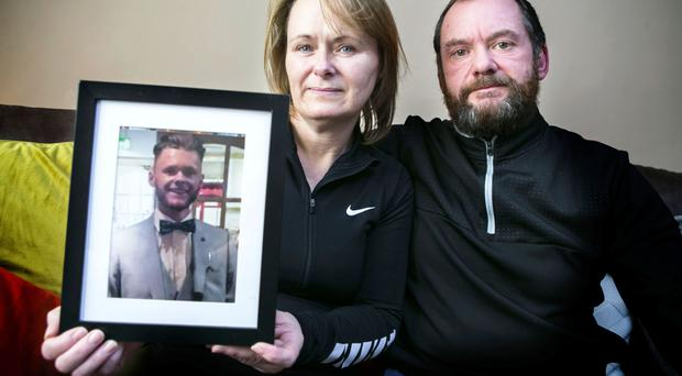 Catherine and Mark Grimes with a picture of son Callum